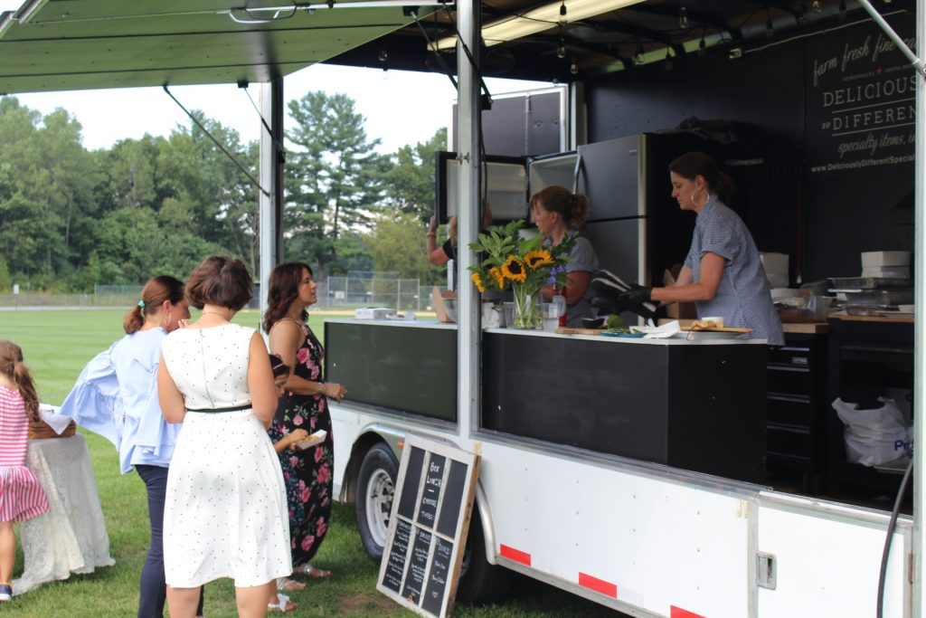 Deliciously Different catering truck serving attendees at Croquet on the Green 2019