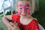 Young girl with a butterfly painted on her face at Croquet on the Green 2019