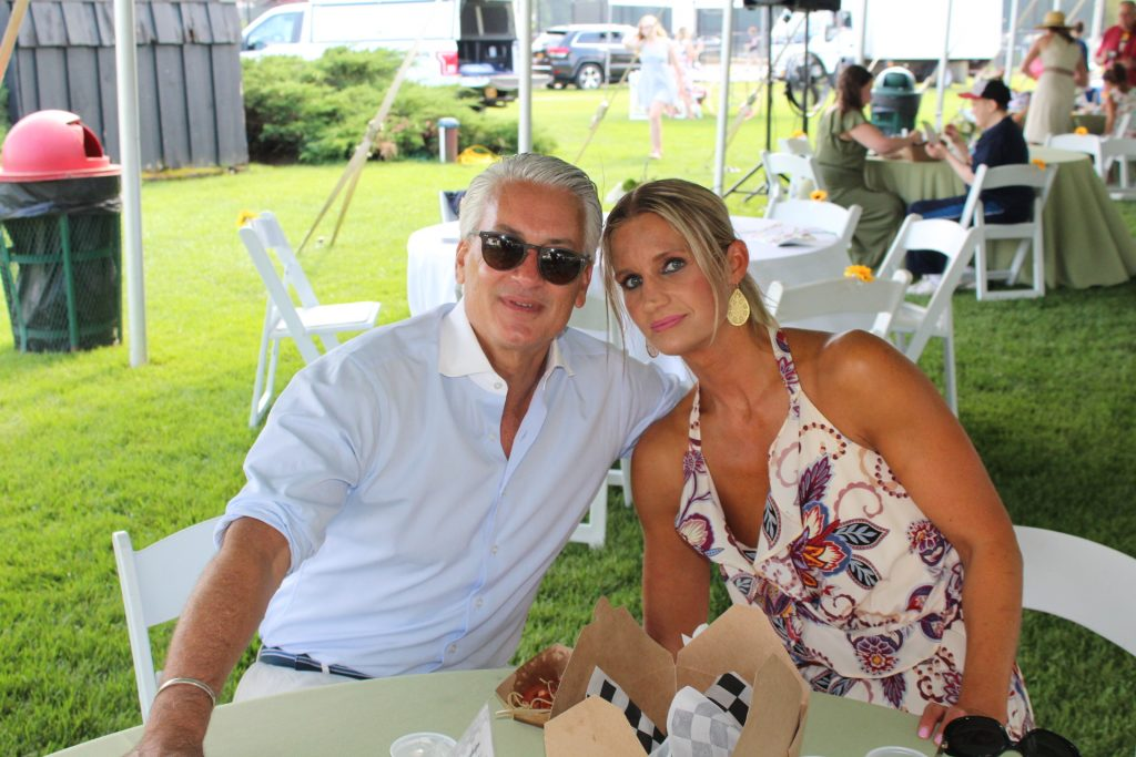 Couple sitting at table at Croquet on the Green 2019