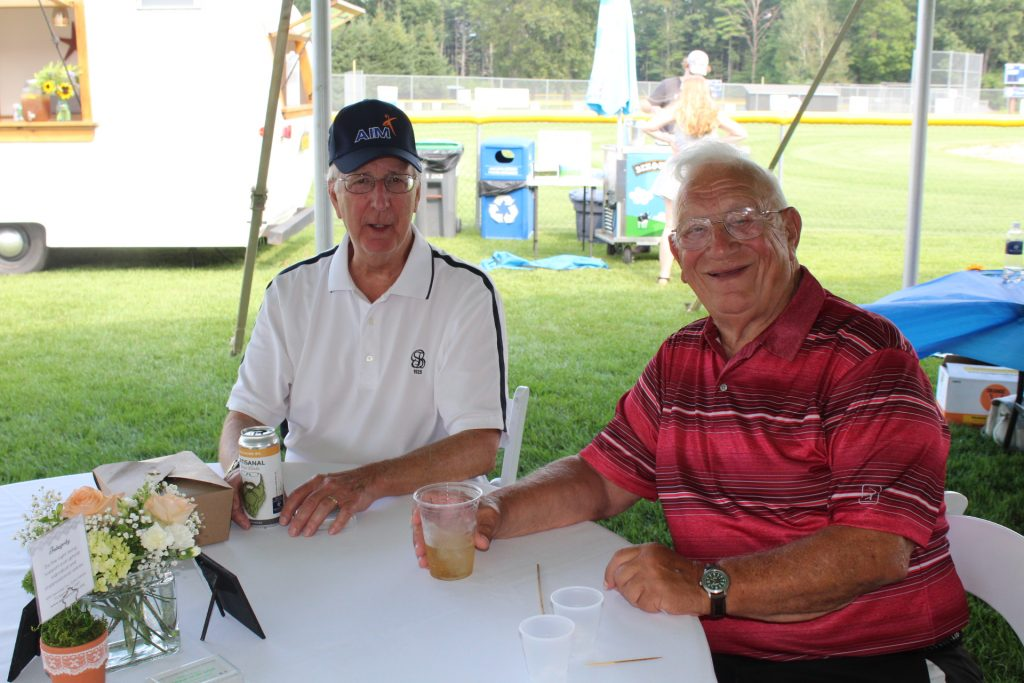 Board member Bob Ricketts with friend at table at Croquet on the Green 2019