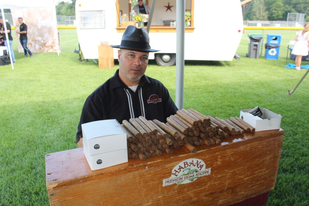 Habana Premium Cigar Shoppe rolling cigars at Croquet on the Green 2019