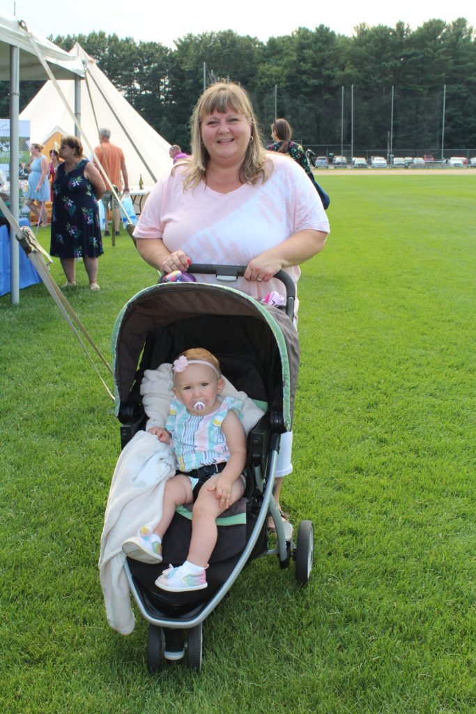 Woman with baby in stroller at Croquet on the Green 2019