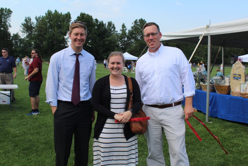 Paul Von Schenk of Amsure with Greg Dixon and co-worker from the Wesley Community at Croquet on the Green 2019