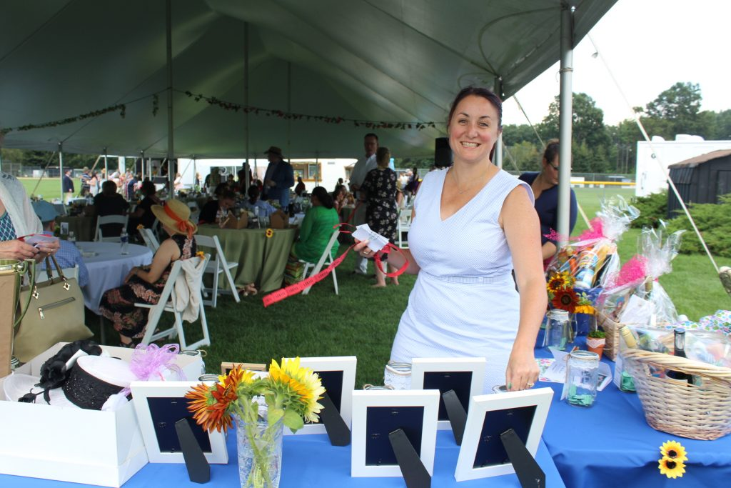 Tara Pleat in front of raffle at Croquet on the Green 2019
