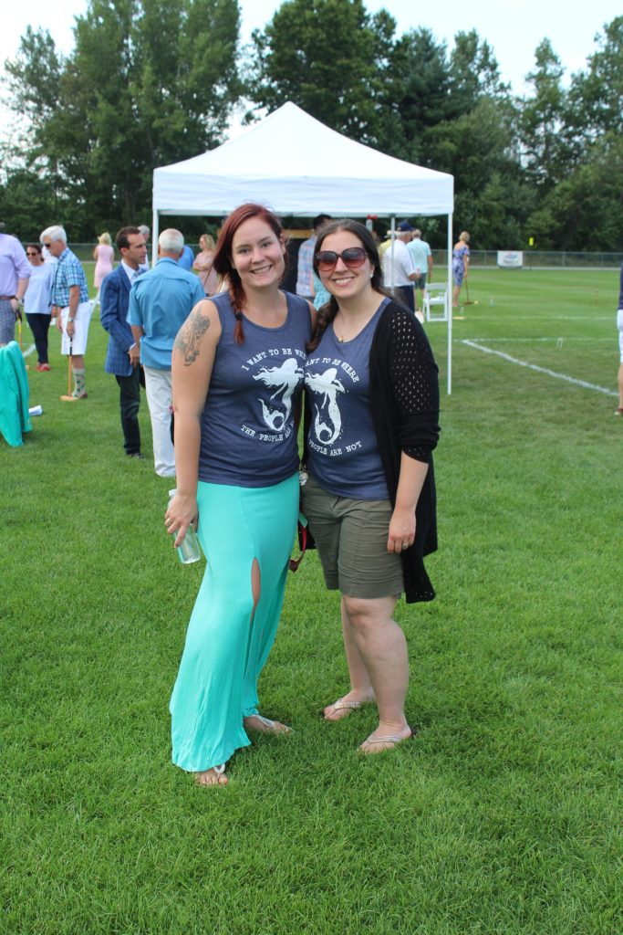 "Two woman wearing ""I want to be where the people are not"" with mermaids on them matching shirts at Croquet on the Green 2019"