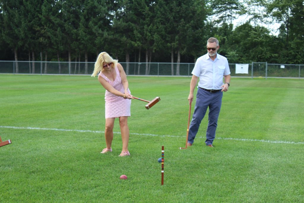 Aimee Taylor and Gary Dake playing croquet at Croquet on the Green 2019