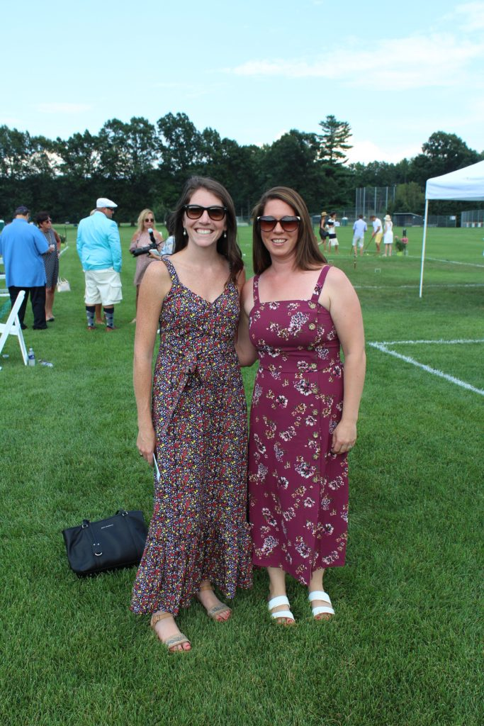 Two women in floral maxi dresses smiling at Croquet on the Green 2019