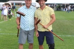 Father and son holding croquet mallets and smiling at Croquet on the Green 2019