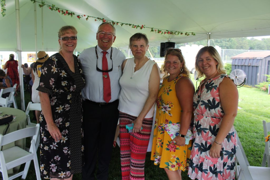 Tom Flynn of Jaeger & Flynn with four other AIM staff members in bright colored clothing at Croquet on the Green 2019