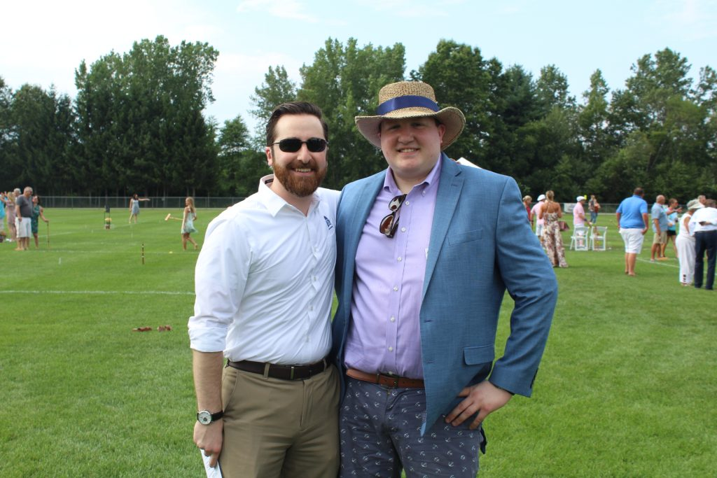 Two men dressed up on croquet field at Croquet the Green 2019