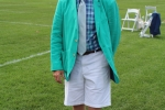 Man in bright colored aqua jacket with knee high socks with birds on them at Croquet on the Green 2019