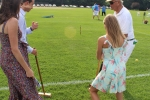 Croquet expert showing three people how to play croquet at Croquet on the Green 2019