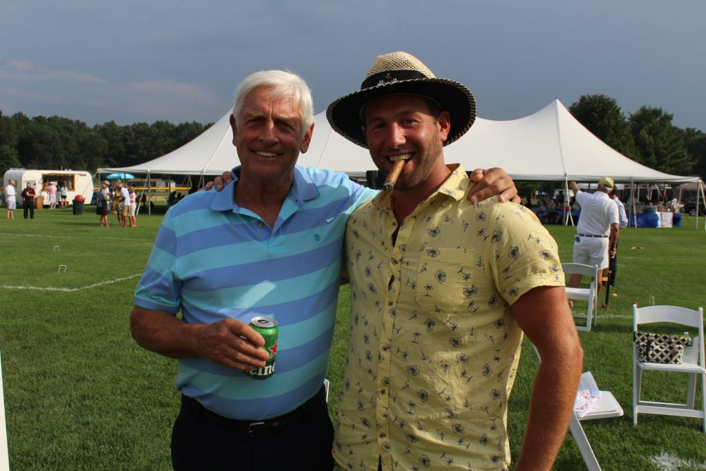 Two men smiling at Croquet on the Green 2019