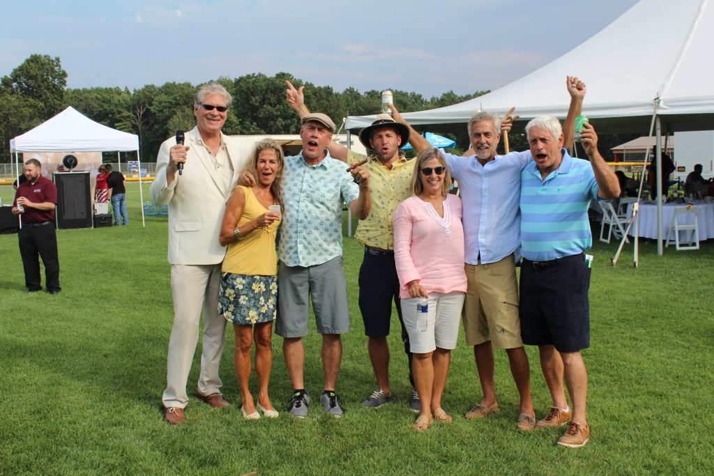 Group of seven people cheering at Croquet on the Green 2019