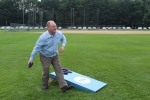 Man throwing bag and playing corn hole at Croquet on the Green 2019