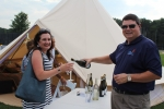 Brian Gwynn of Specialty Wines and More pouring sparkling wine for a woman