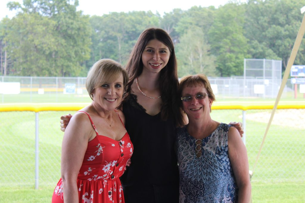 Three women smiling together at Croquet on the Green 2019