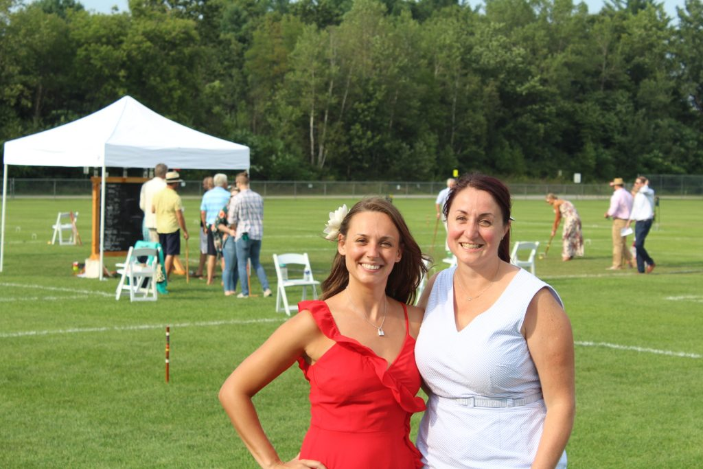 Marissa Romero with Tara Anne Pleat of Wilcenski & Pleat PLLC together smiling at Croquet on the Green 2019