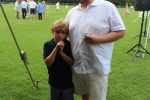 Father and young son smiling together at Croquet on the Green 2019