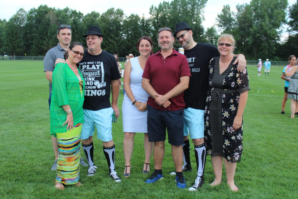 Group of seven people together smiling at Croquet on the Green 2019