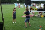 Young boy hula hooping as young girl looks on at Croquet on the Green 2019