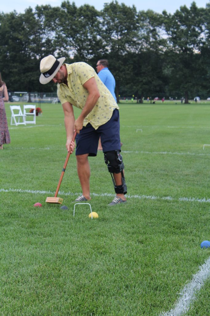 Man taking a shot at croquet at Croquet on the Green 2019