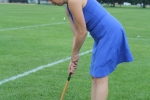 Woman in a blue dress taking a shot at croquet at Croquet on the Green 2019