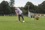 Matt Stevens mid-shot hitting a croquet ball at Croquet on the Green 2019