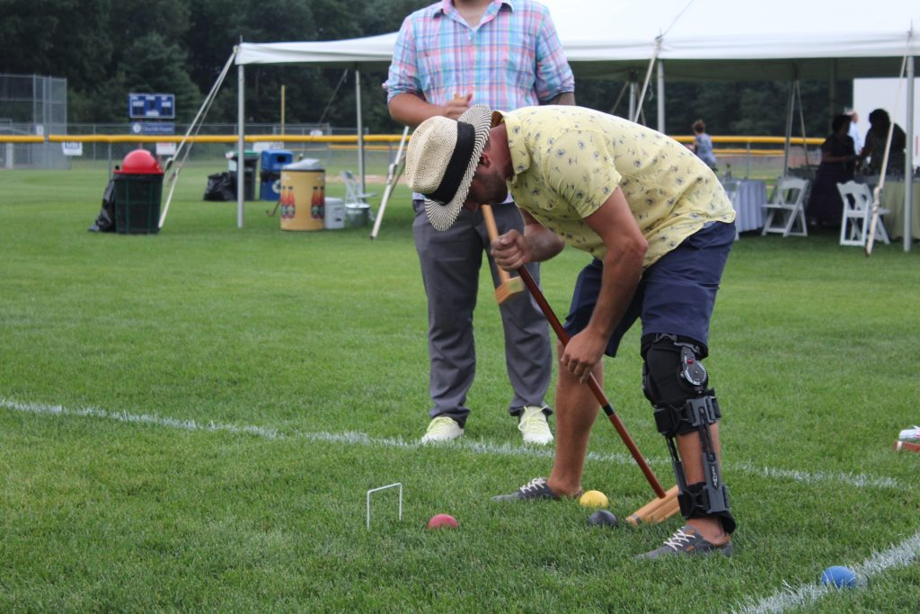Man lining up his shot for croquet at Croquet on the Green 2019