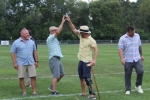 Two men high fiving on croquet field at Croquet on the Green 2019
