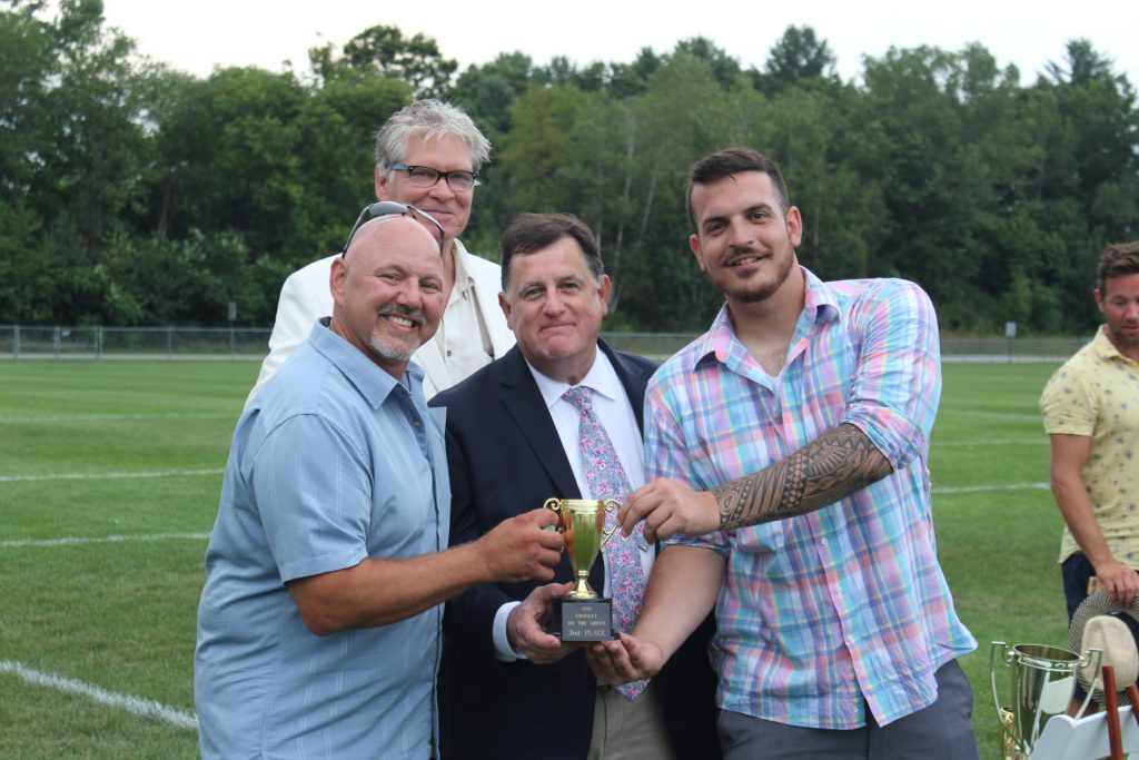 2nd place winners of Croquet, Bob Wiltsie and Matt Stevens, holding their trophy with Chris Lyons and Walt Adams with them at Croquet on the Green 2019