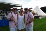 Woman with two men in matching croquet outfits at Croquet on the Green 2019