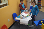 two children at art table