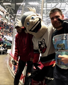 Two people with Adirondack Thunder mascot