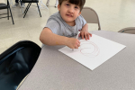 kid drawing on paper