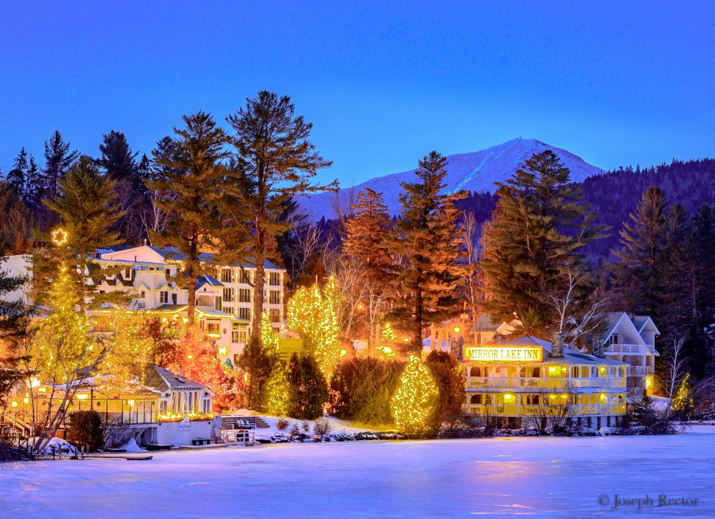 Mirror Lake Inn hotel in winter across lake view
