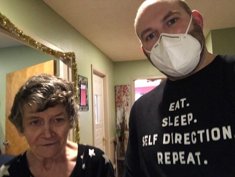 Josh Phelps wearing s mask with an older woman