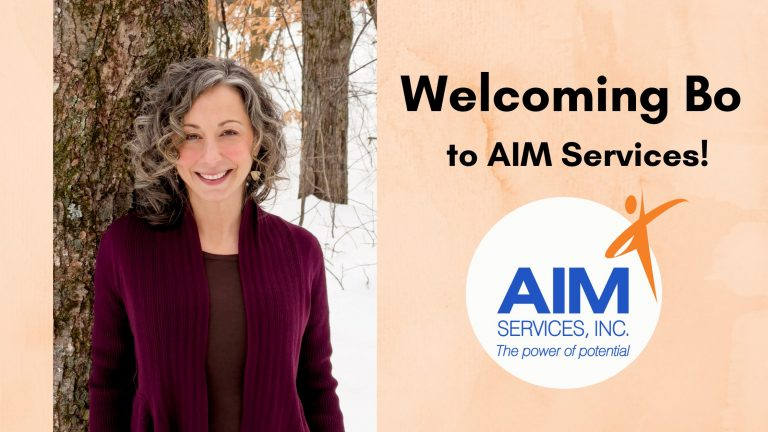 "Photo of Bo Goliber with orange background text that says ""Welcoming Bo to AIM Services!"" and AIM logo"