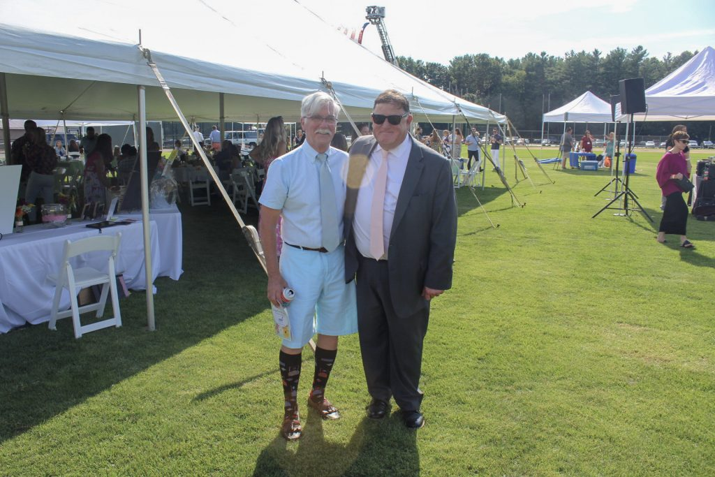 Dave Shantz with Chris Lyons in front of large tent at AIM Services Croquet on the Green 2021