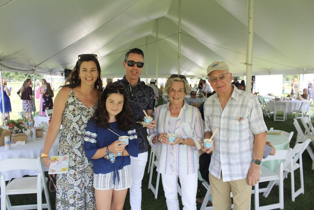 Group of five people of all ages holding ice cream at AIM Services Croquet on the Green 2021