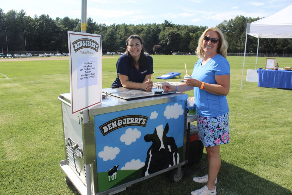 Ben & Jerry's ice cream cart with two people smiling next to it at AIM Services Croquet on the Green 2021
