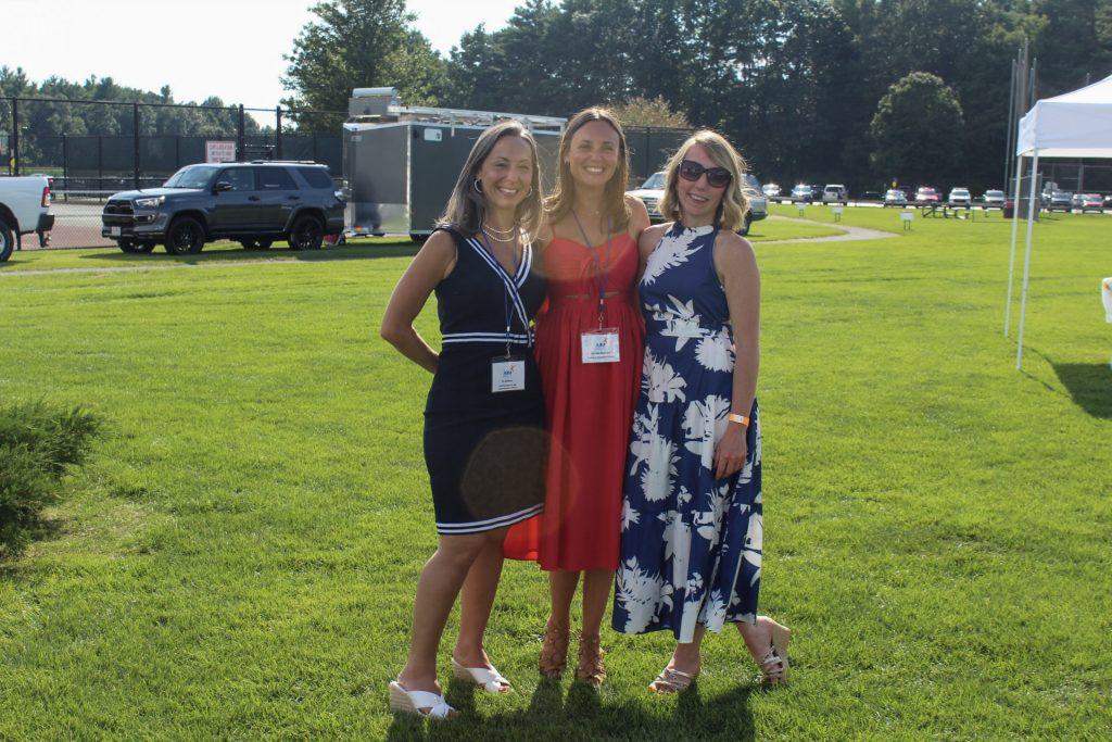 Bo Goliber, Marissa Romero, and Diane Hall smiling together at AIM Services Croquet on the Green 2021
