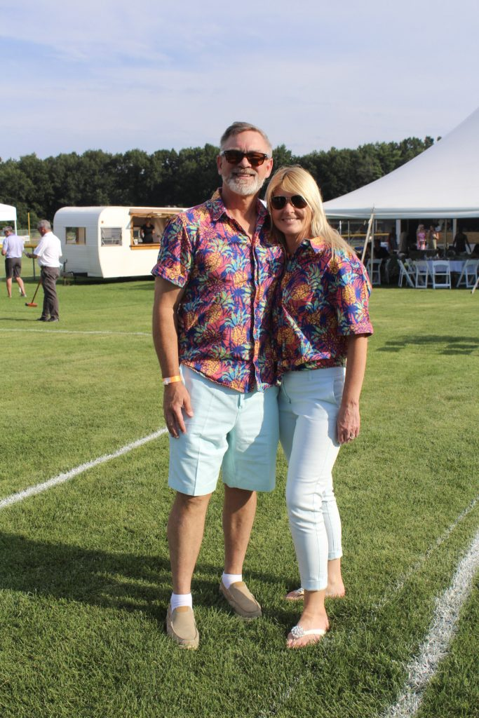 Gary Dake and Aimee Dake in matching Hawaiian shirts and light green bottom outfits at AIM Services Croquet on the Green 2021
