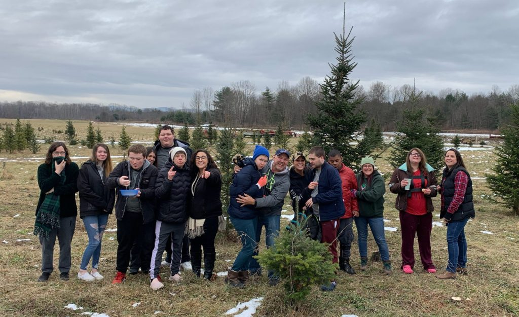 Group of people at a tree farm