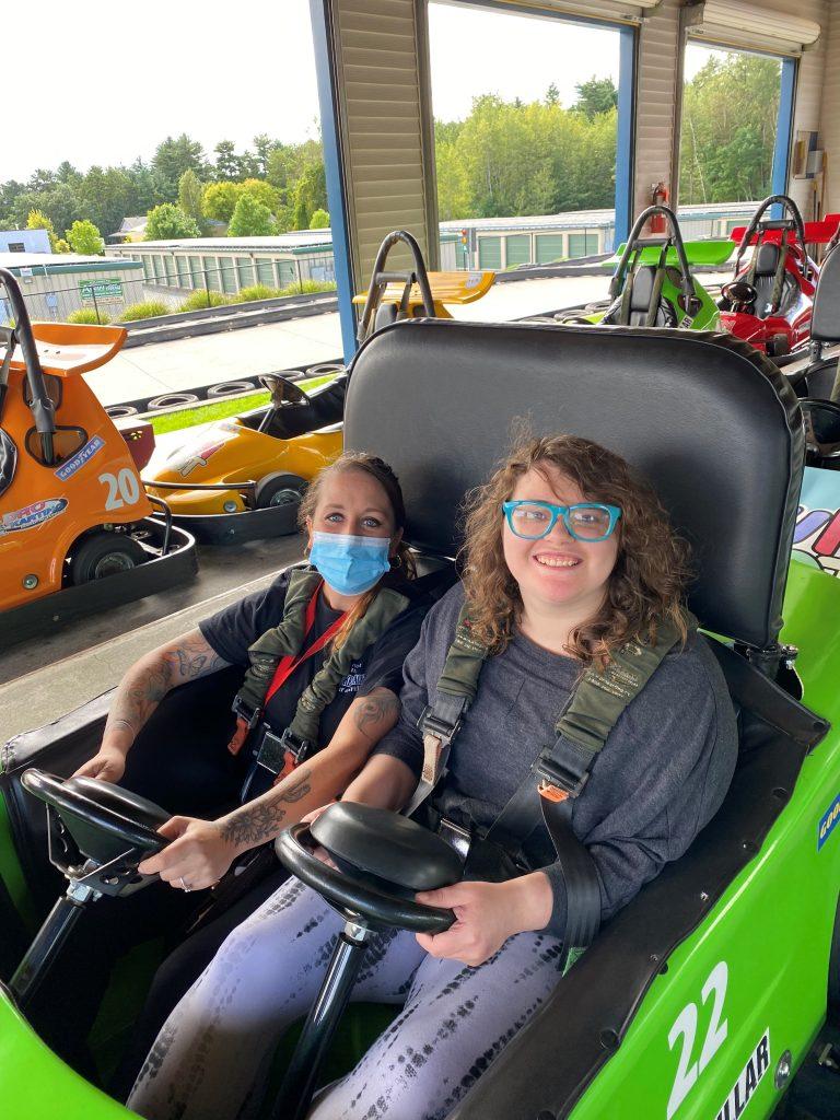 Two women in a go-kart
